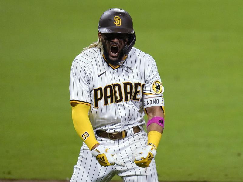 Fernando Tatis Jr. reacts after hitting a three-run home run