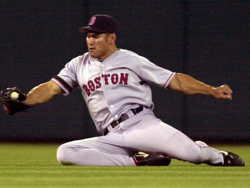 Boston Red Sox's Johnny Damon slides to catch ball