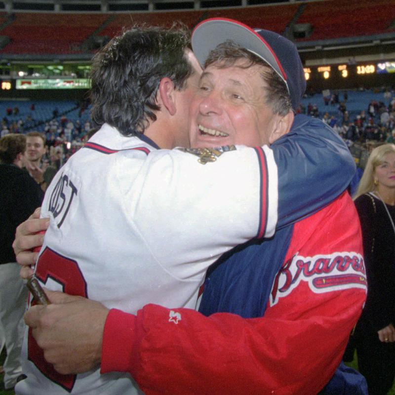 Bobby Cox hugs bullpen coach Ned Yost