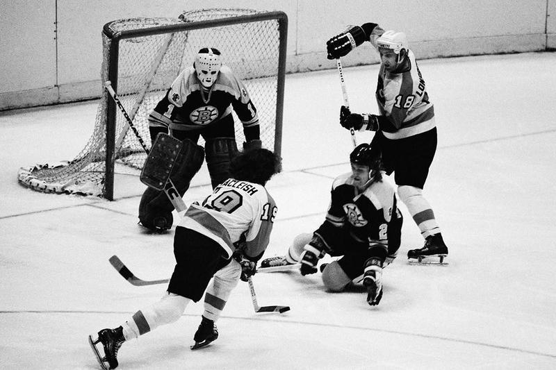Boston Bruins goalie Gil Gilbert and defenseman Al Sims