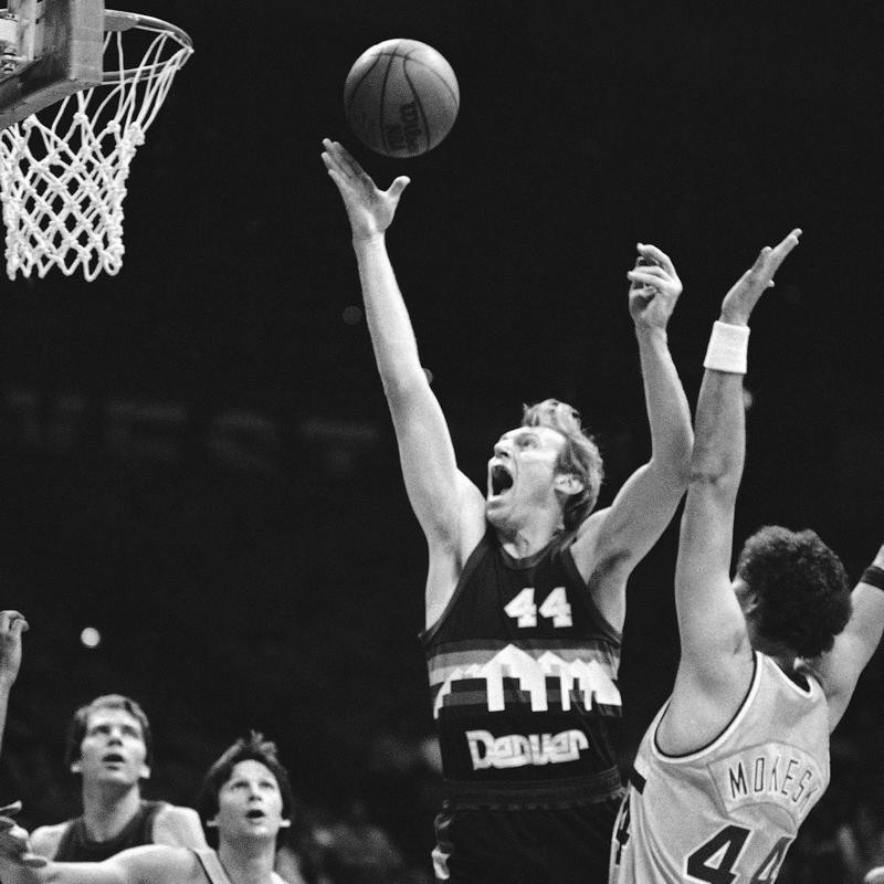 Denver Nuggets center Dan Issel lets out yelp as he out positions Cleveland Cavalier center Paul Mokeski