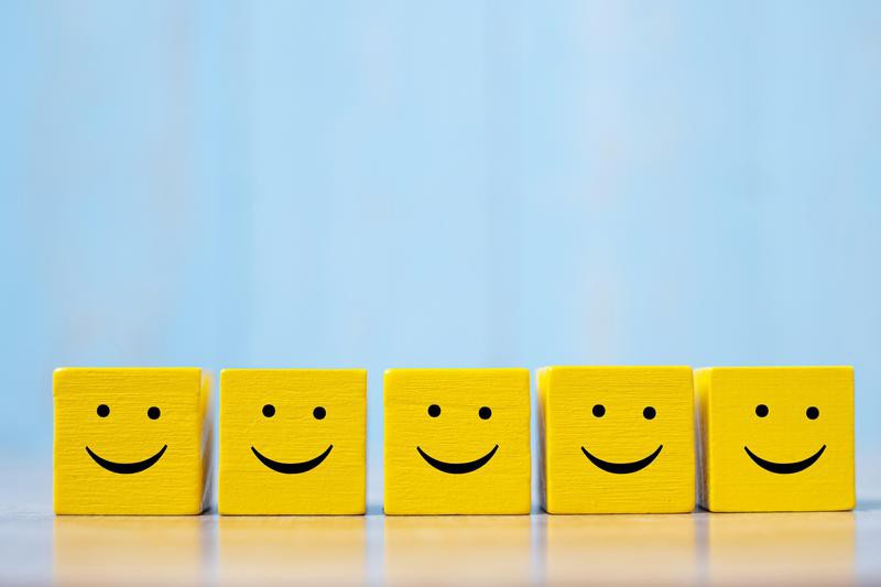 Smiles on yellow cubes
