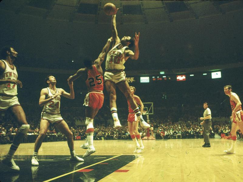 New York Knicks guard Walt Frazier jumps high