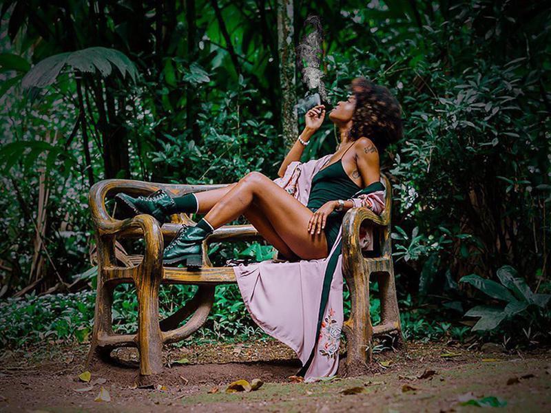 Woman posing for Epican Jamaica dispensary