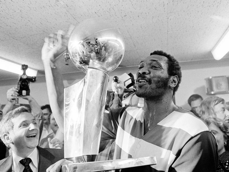 Washington Bullets player Elvin Hayes holds NBA Championship trophy