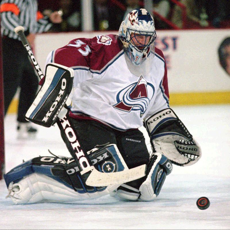Patrick Roy makes a save against the Chicago Blackhawks
