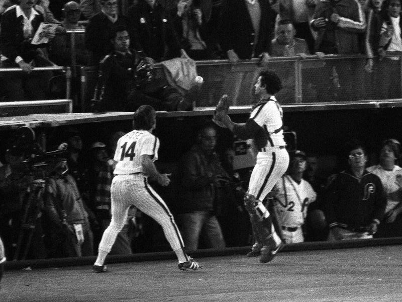 Bob Boone and teammate Pete Rose move to make foul pop fly catch in World Series