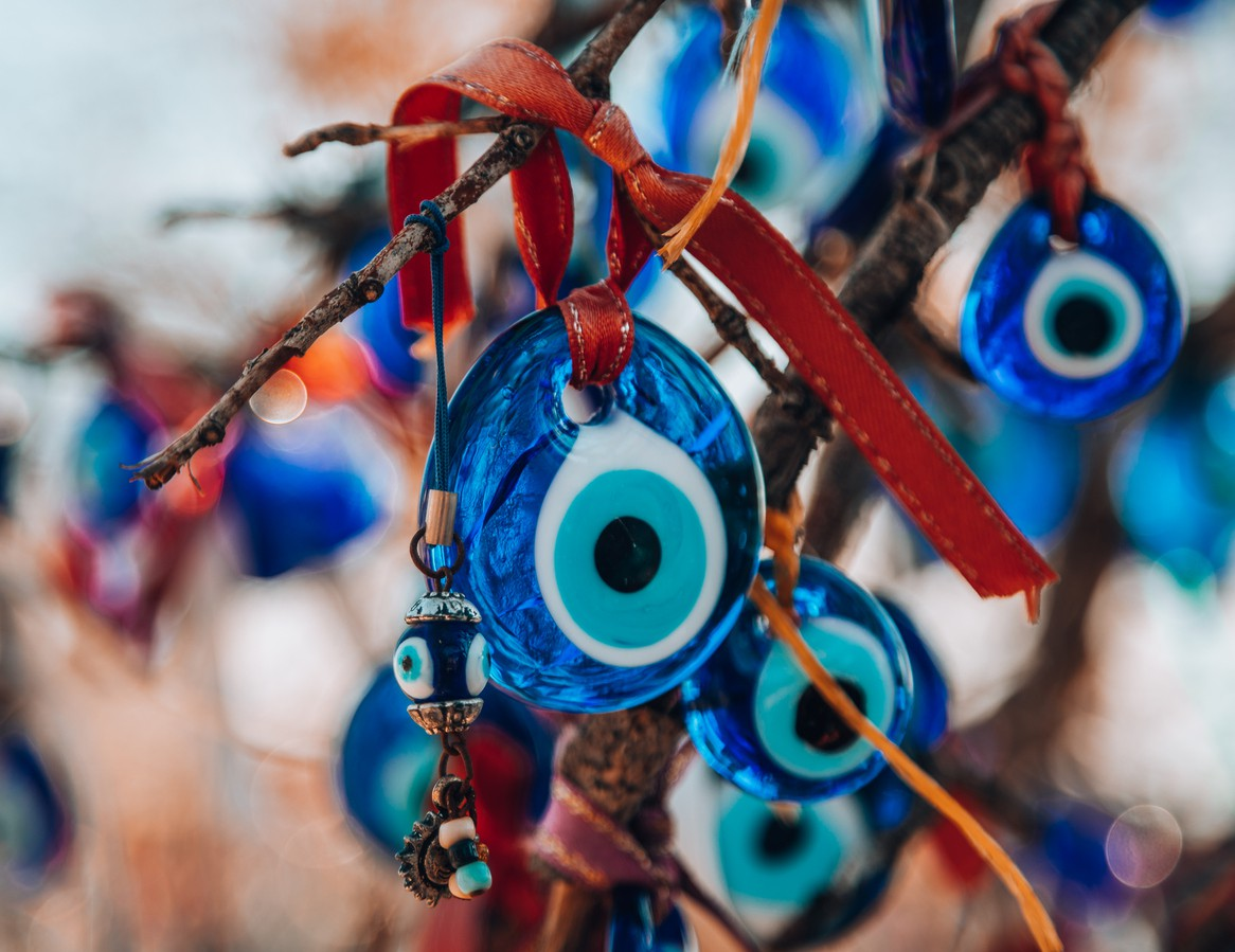 Evil eye charms hanging on tree