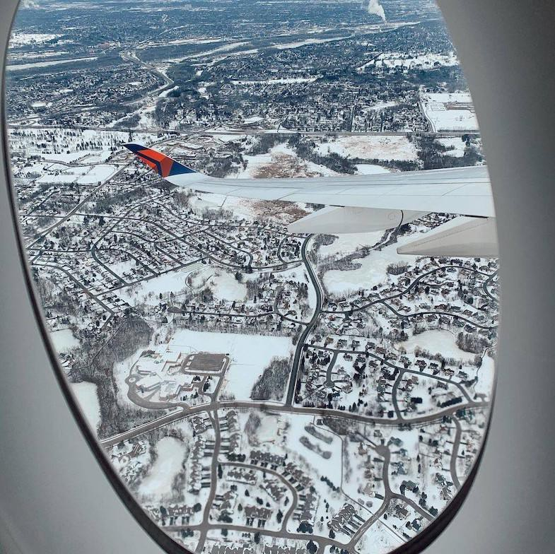 View of snowy landscape from Delta aircraft