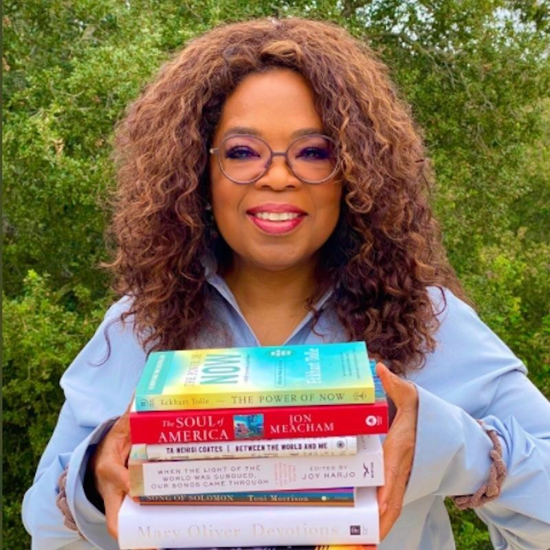 Oprah posing with books for her book club