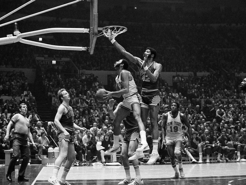 Walt Frazier goes up to basket
