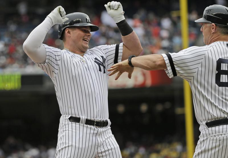 Luke Voit celebrates his home run as he rounds the bases during the first inning of a baseball game against the San Diego Padres