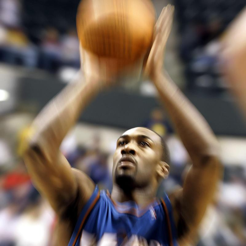 Gilbert Arenas shoots free throw with motion blur