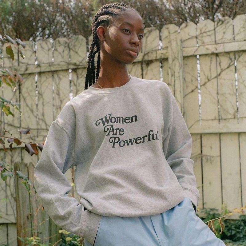 Woman in women are powerful sweatshirt