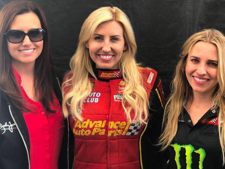 Courtney Force poses with people