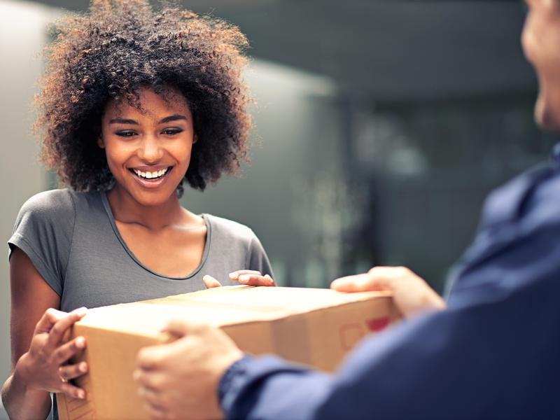 Woman happy to get a delivery