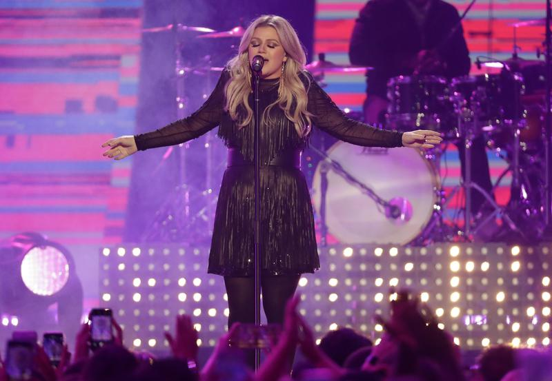 Kelly Clarkson performs at the CMT Music Awards in Nashville, Tennessee, in 2018.