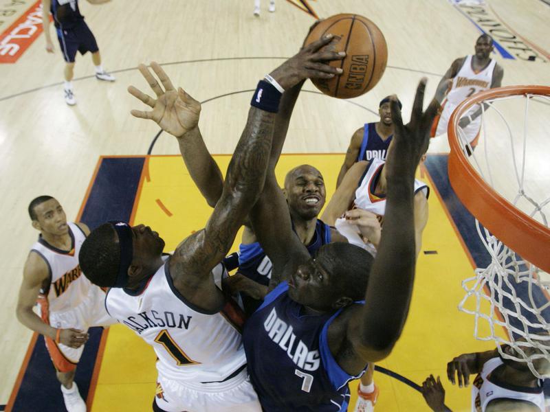 Dallas Mavericks' DeSagna Diop and Jerry Stackhouse fight for rebound