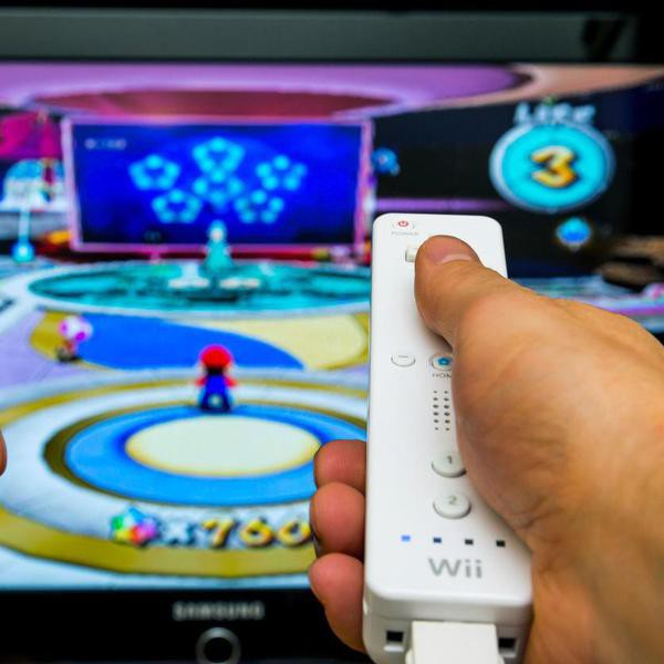 Neeroeteren, Belgium - February 10, 2013:The Wii  in action. The Wii remote and Nunchuck seen in front of a tv screen, where Super Mario galaxy is being played. The Wii is a game console from Nintendo, and was released in 2006. The game Super Mario galaxy was released in 2007.
