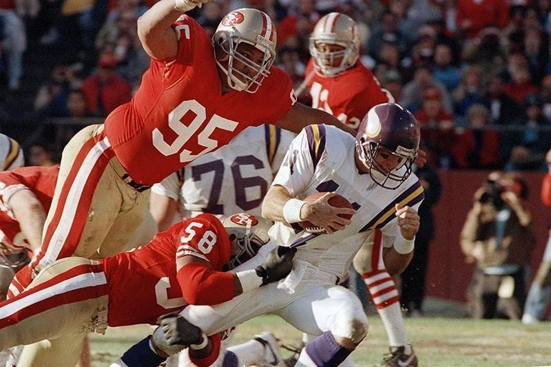 Michael Carter sacks Minnesota Vikings quarterback Wade Wilson