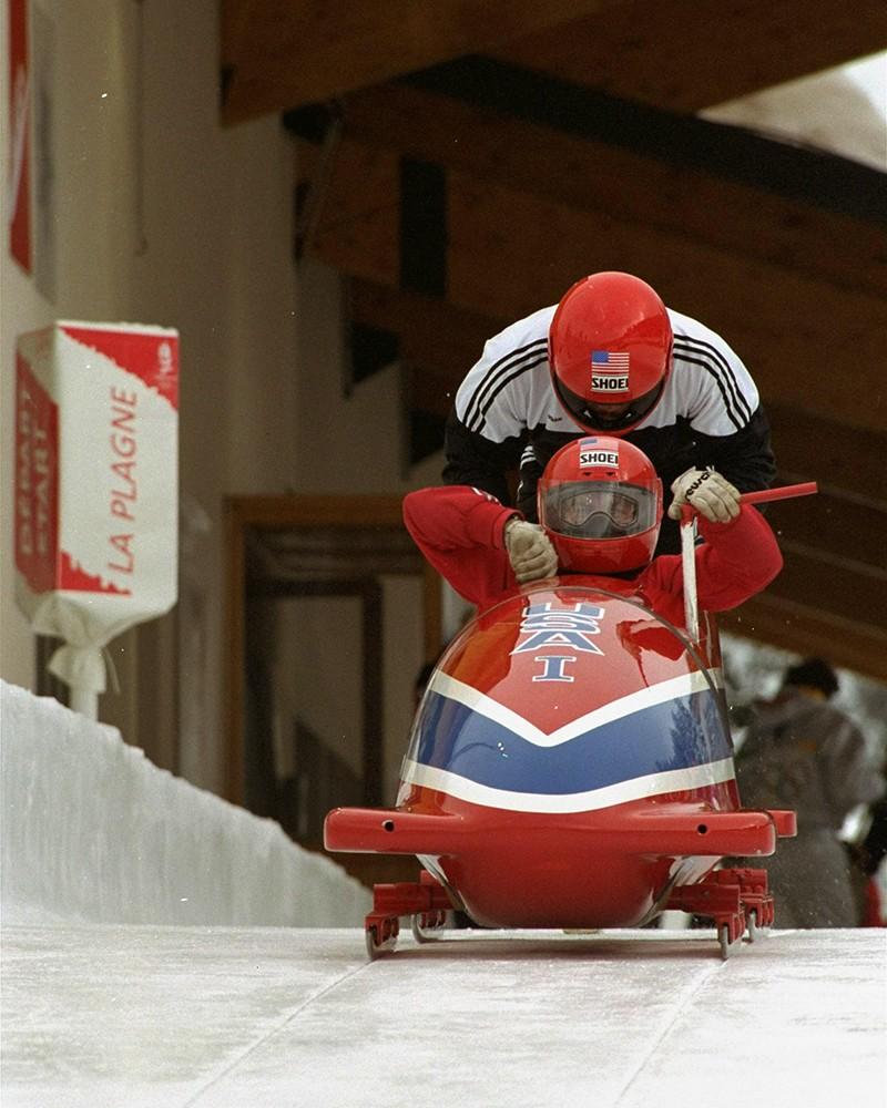Herschel Walker practicing bobsled at 1992 Winter Olympics