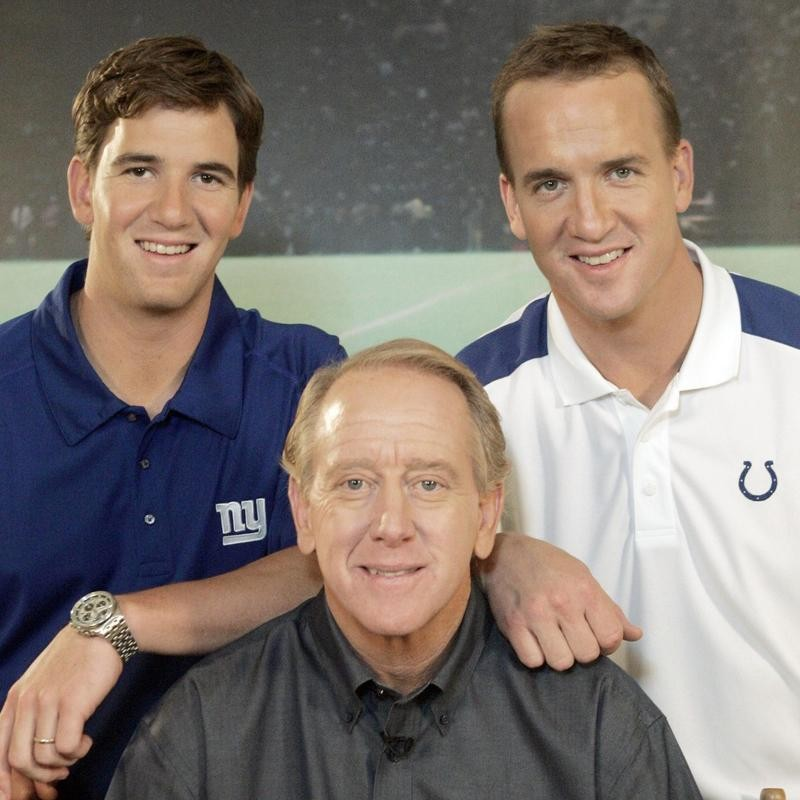 Archie Manning poses with Eli Manning and Peyton Manning on set of DirecTV commercial