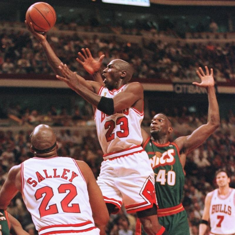 John Salley provides support to Michael Jordan against the Seattle SuperSonics