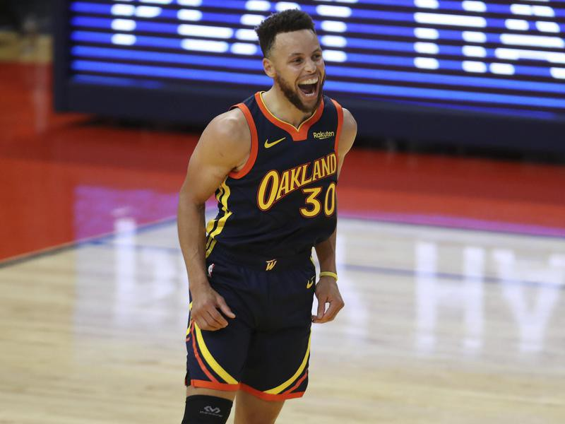 Golden State Warriors guard Stephen Curry yells