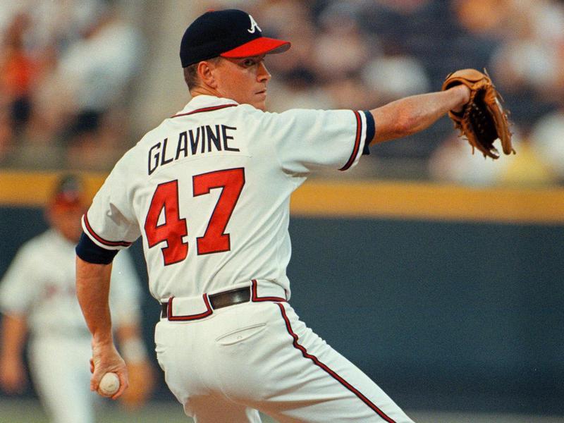 Atlanta Braves starting pitcher Tom Glavine delivers to Houston Astros batter
