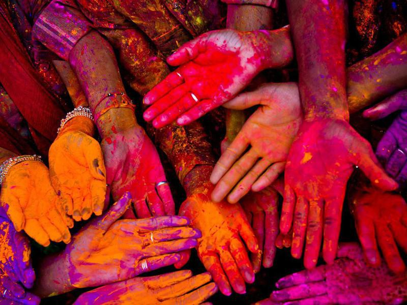 Holi festival in India with colorful hands