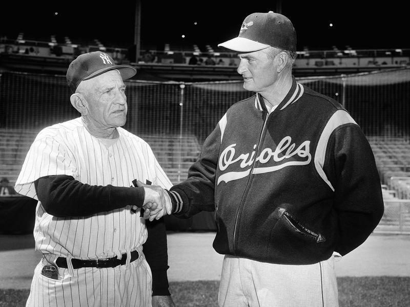 New York manager Casey Stengel and manager Paul Richards handshake