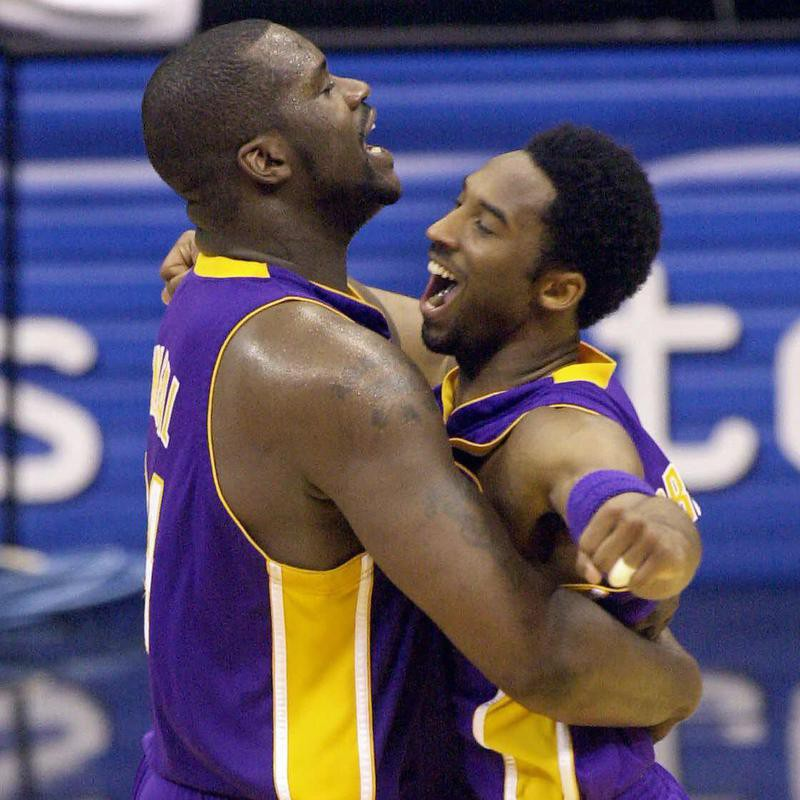 Los Angeles Lakers' Shaquille O'Neal and Kobe Bryant embracing