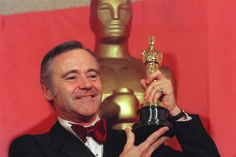 Jack Lemmon holding an Oscar