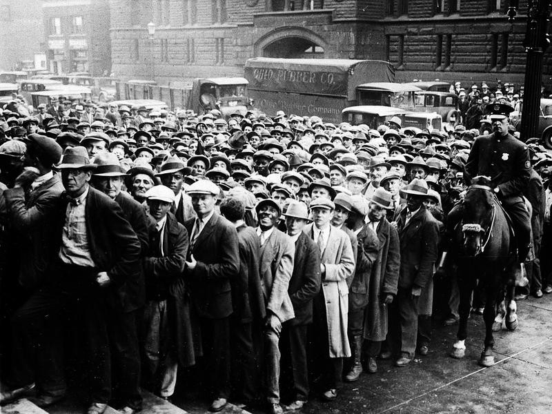 People lining up for jobs during the Great Depression