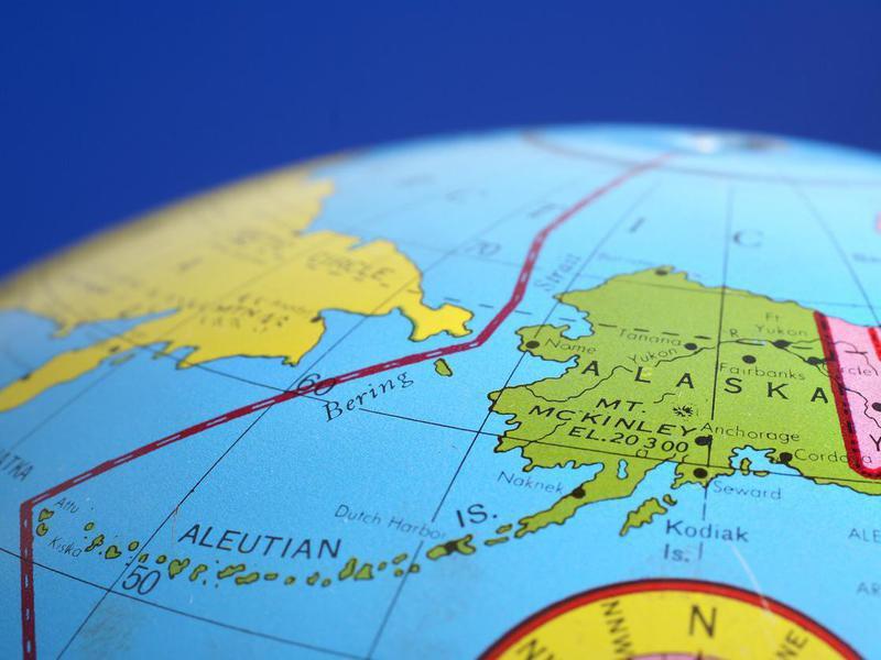 A round globe focused on Alaska.