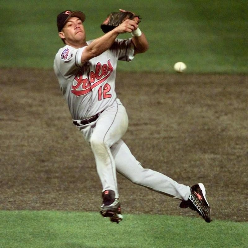 Roberto Alomar throws out Roberts of the Cleveland Indians in American League Championship Series