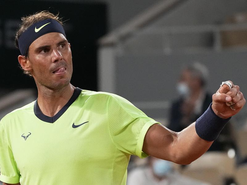 Spain's Rafael Nadal clenches fist as he plays Serbia's Novak Djokovic
