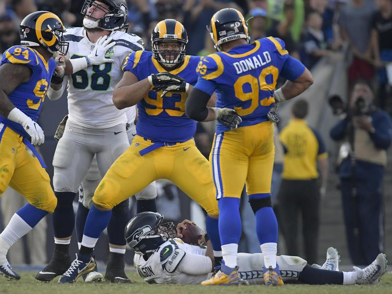 Ndamukong Suh celebrates after sacking Russell Wilson of the Seattle Seahawks