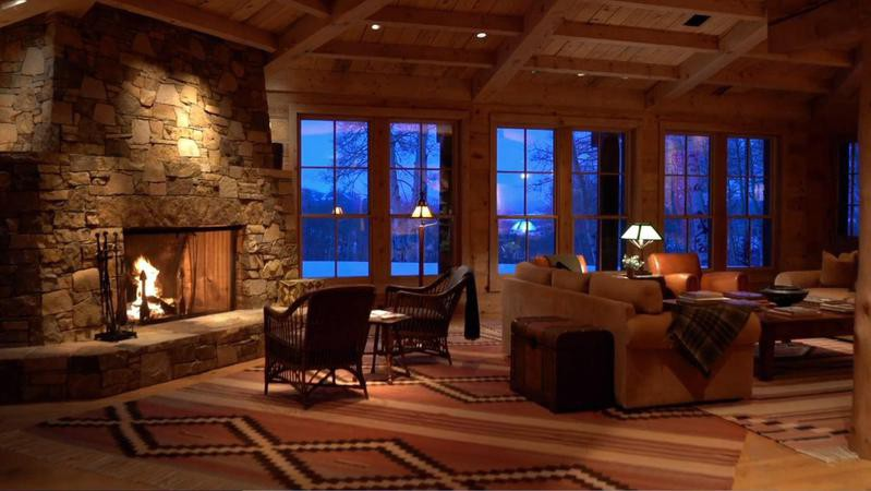 Large stone fireplace in wood ranch home