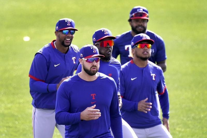 Texas Rangers outfielders Leody Taveras, Joey Gallo, Adolis Garcia, Willie Calhoun and Delino DeShields