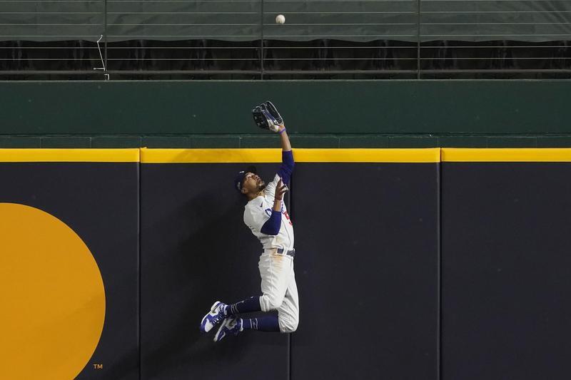 Mookie Betts of the Los Angeles Dodgers robs Atlanta Braves' Freddie Freeman of home run