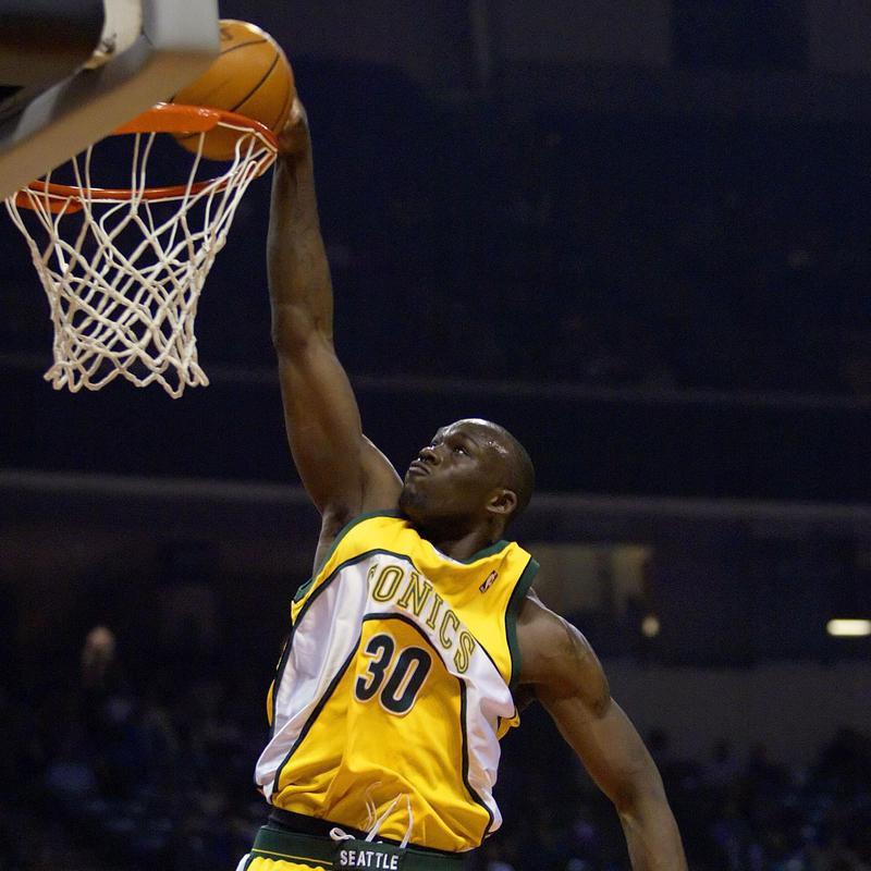 Seattle SuperSonics' Reggie Evans dunks in front of Charlotte Bobcats' Emeka Okafor