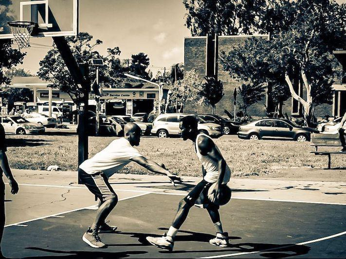 Men playing at Mosswood Park Basketball Courts