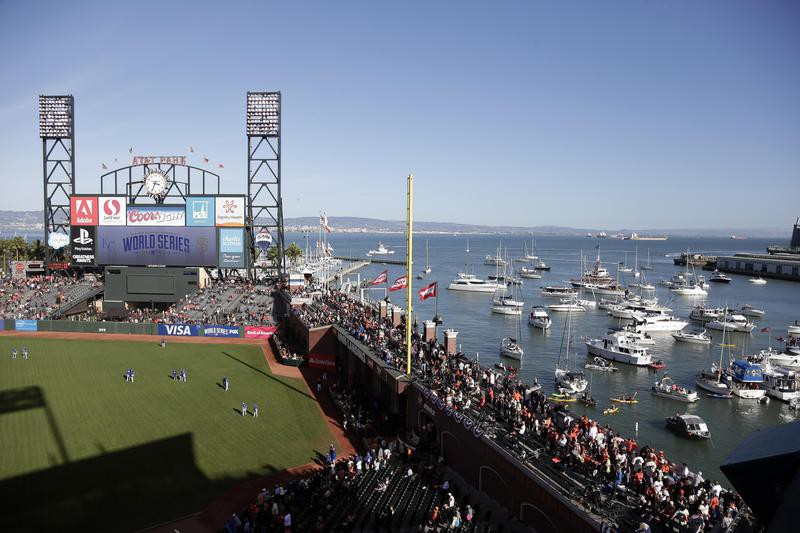 Boats and kayaks fill into McCovey Cove