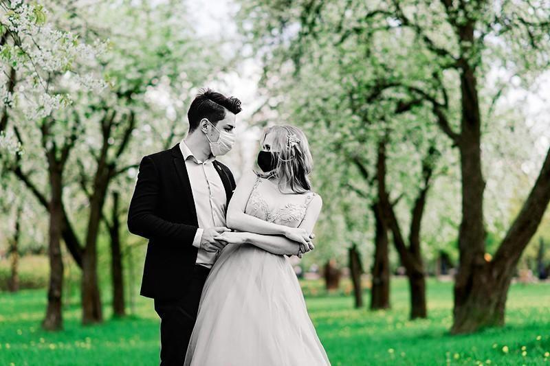 newlyweds in masks