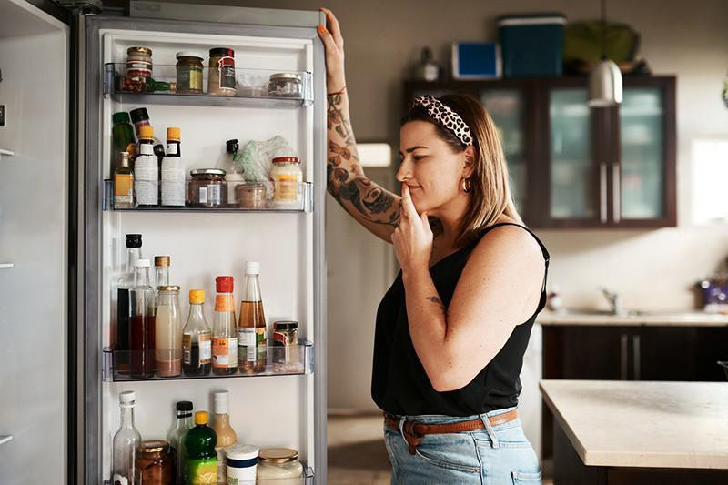 Checking the refrigerator