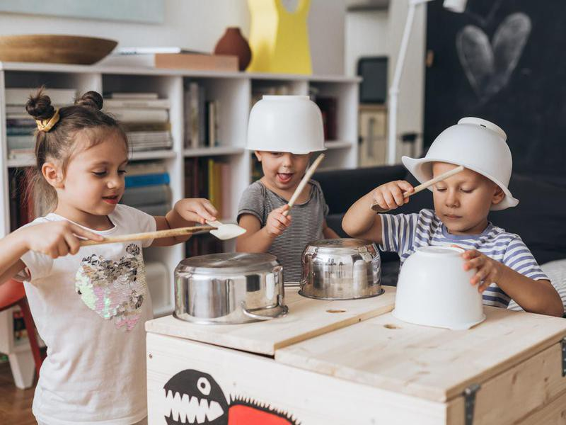 Kids playing with pots and pans