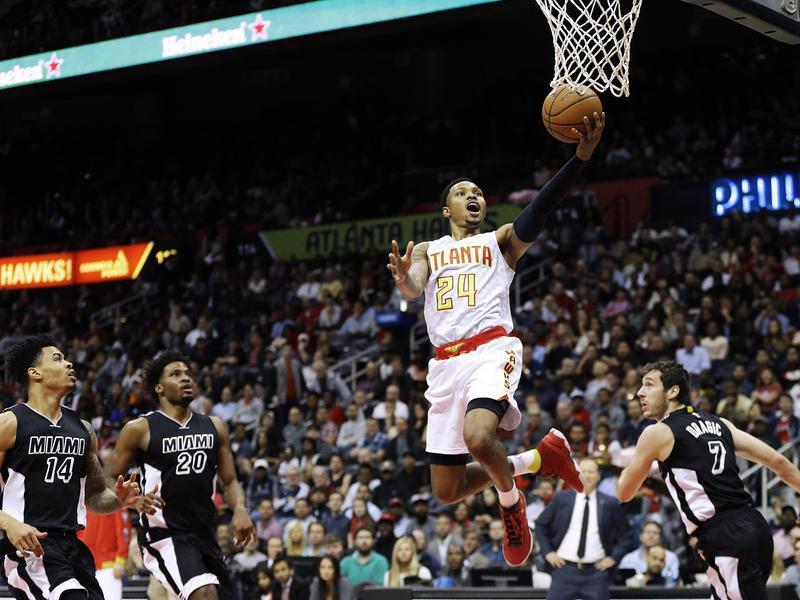 Kent Bazemore scores a basket