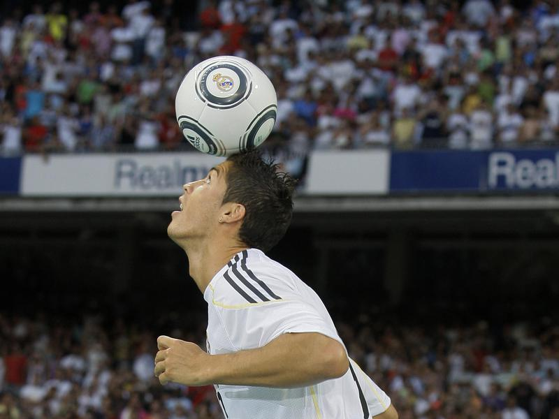 Real Madrid's Cristiano Ronaldo does tricks with the ball at the Santiago Bernabeu stadium in Madrid.