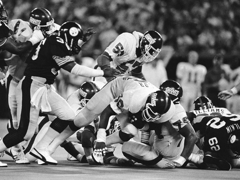Mike Webster takes down Lawrence Taylor